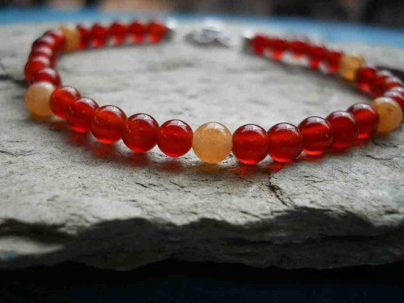 Handmade light and dark orange carnelian stretchy bangle by FeekoByDesign, $14.00