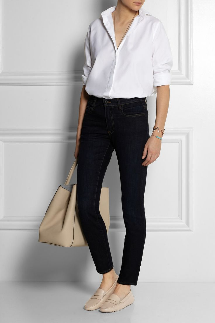 Neutral colored loafers for spring summer styled with white shirt, dark blue skinny jeans.
