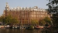 """Grand Hotel Amrâth Amsterdam, Amsterdam. Grand Hotel Amrâth Amsterdam is located in """"Het Scheepvaarthuis"""", 500m from Central Station and 1100m from Dam Square."""