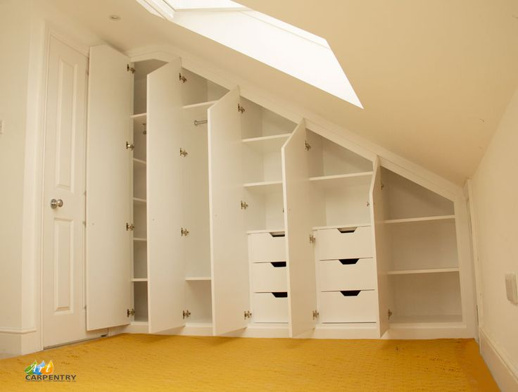 Loft Attic Wardrobe.Contemporary MDF sloping wardrobe fitted in the loft spare room. Another sample of fitted furniture created by our company is plain contemporary door wardrobe with cupboards and drawers along sloping ceiling. Good solution to fill dead space in your attic room. Supplied, fitted and painted by Art Carpentry in Putney, London.
