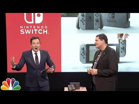 Nintendo president Reggie Fils-Aimé dropped by The Tonight Show to give a sneak peek of the new Nintendo Switch console to Jimmy Fallon.