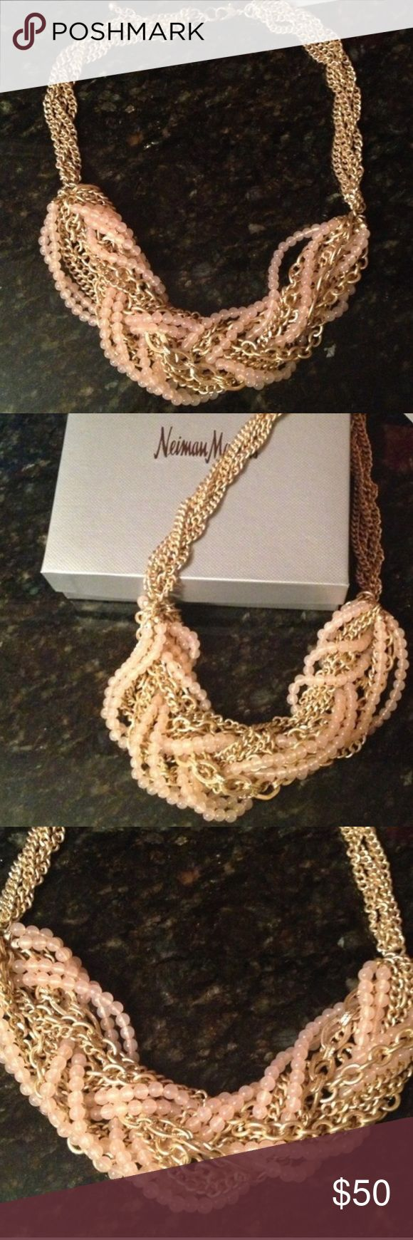 Chunky gold and pink statement necklace. Statement necklace bought from Neiman Marcus. (Lydell NYC) Gold chains and pink beads. Absolutely stunning. Only worn once. Adjustable clasp closure. Comes with Neiman Marcus gift box. Neiman Marcus Jewelry Necklaces