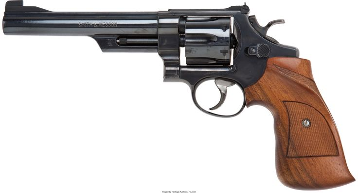 .45 ACP Smith & Wesson Model 25-2 Double Action Revolver. Serial no. N66752, .45 ACP caliber, 6 1/2-inch barrel with target sights and marked on right side: .45 cal. Model 1955. Blued finish. Case-hardened hammer and trigger. Checkered walnut competition grips with thumbrest and contour grip.