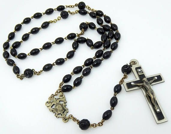 Image result for free photo of old black rosary beads and soldier