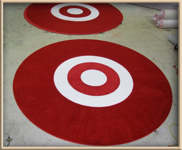 Round Red Rugs With White Inlays Made For.well You Guessed It.
