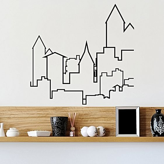 Silhouetted in beautiful style, the City Serenity Wall Decal from Campfire Graphics brings a stunning skyscraper landscape to your blank wall.