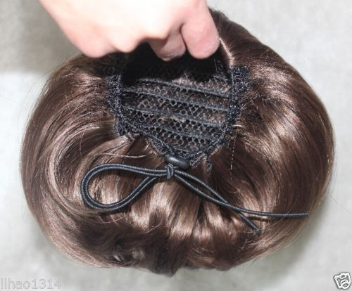 How to style: Rather than winding it into the hair, however, simply place the scrunchie over the bun, sliding it down as close to your head as you can. It should sit neatly all the way around – you can secure it with a couple of bobby pins if necessary.