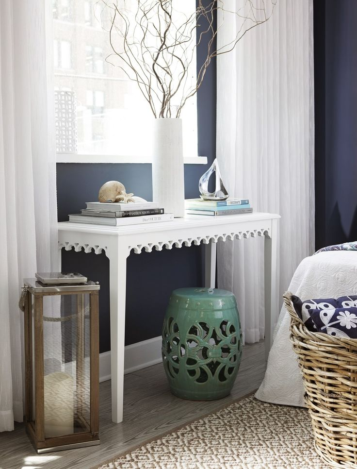 Navy or charcoal walls, crisp white drapes.  Homesense Cottage Guest Bedroom 5