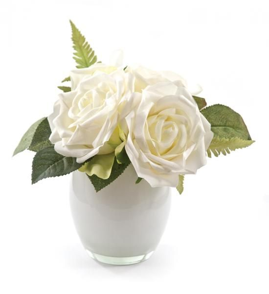 Roses and Fern in a small rounded white vase. Cream. Height 18cm. €16.50
