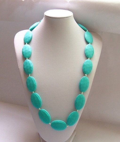 Turqoise silicone teething necklace for mom to wear by PrittyLucky. Safe for baby, comes in cute colors and styles for Mom