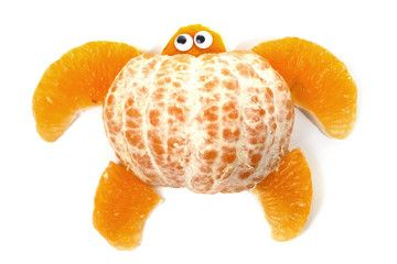 Food art creative concepts. Turtle made of mandarin orange. Funny dessert for children. Fruit isolated on a white background.