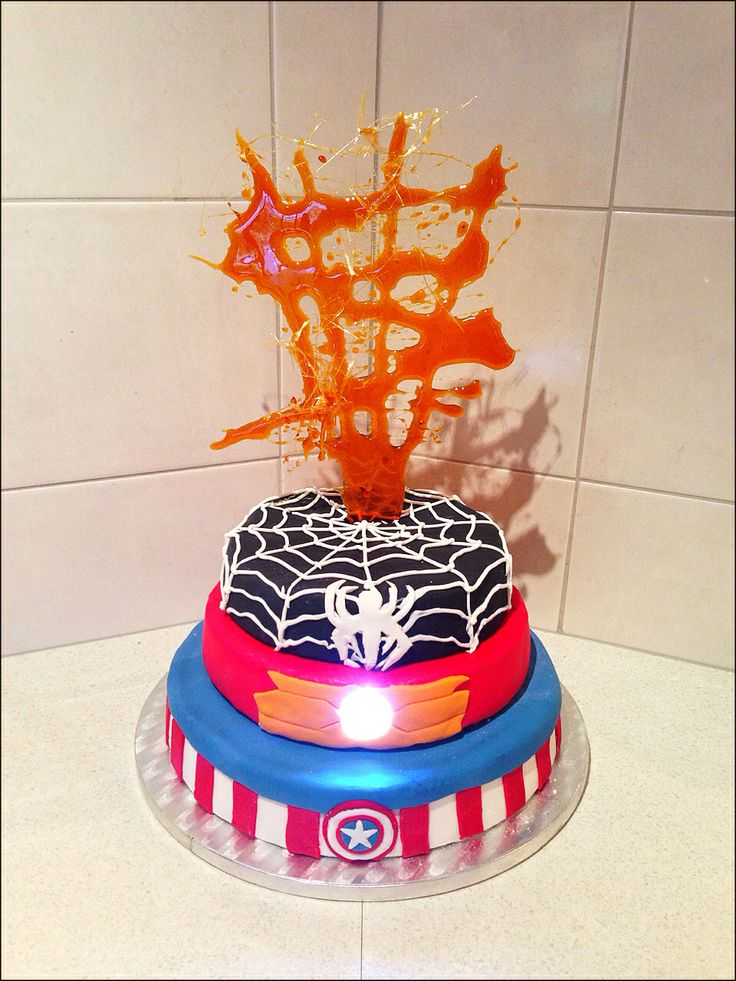 Amazing superhero birthday cake complete with light