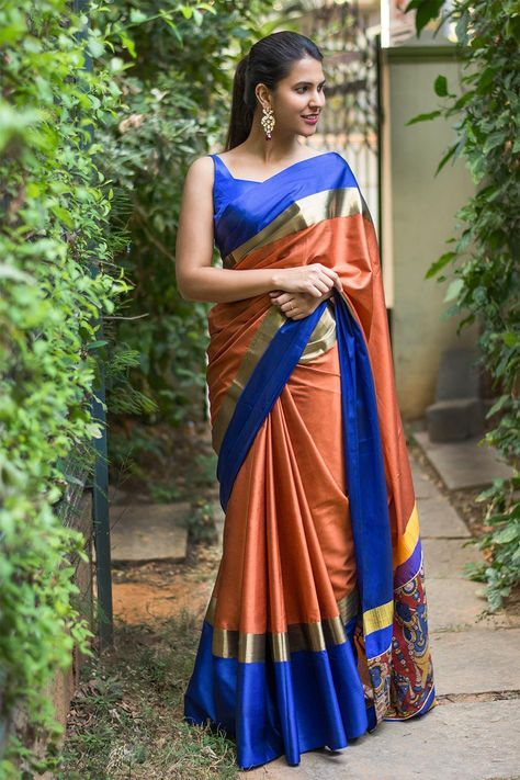 Rust soft cotton silk saree with royal blue and dull gold border and hand painted Kalamkari pallu detailing #saree #blouse #houseofblouse #rust #royalblue #gold #cottonsilk #kalamkari #pallu