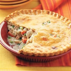 Turkey Potpies Recipe -With its golden brown crust and scrumptious filling, these comforting turkey potpies will warm you down to your toes. Because it makes two, you can eat one now and freeze the other for later. They bake and cut beautifully. —Laurie Jensen, Cadillac, Michigan
