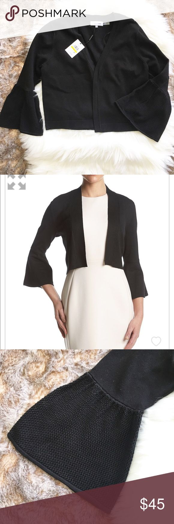 NWT Calvin Klein Black Cropped Bell Sleeve Shrug NWT  CALVIN KLEIN  Black Cropped Shrug Sweater  Crochet Bell Sleeves  Rayon & Nylon  Size Medium  18 inches across + 18 Long 2nd pic is not exact sweater -just similar style Calvin Klein Sweaters Shrugs & Ponchos