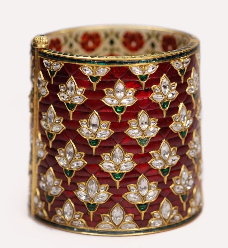 Munnu... Exquisite Cuff Intricately set with Calibrated Rubies accented with Diamond & Emerald Motifs enameled with Gold