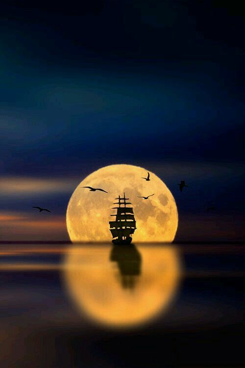 A ship silhouetted in the Moon.