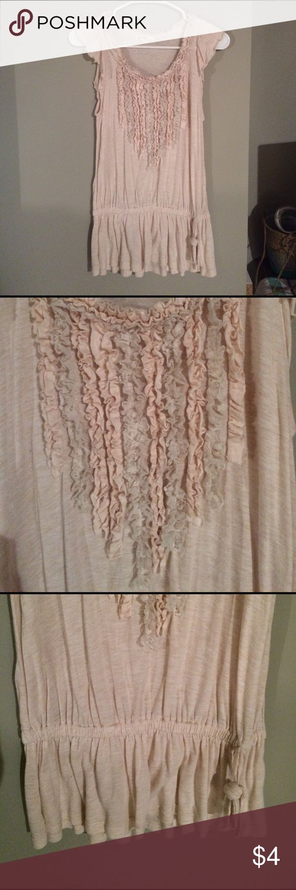 Ruffled Cream Short Sleeved Top Cream with light gray in the ruffles. Front has ruffled. Bottom of shirt has elastic. Ruffled collar and delicate looking sleeves. Soft and delicate feeling. Machine and dryer safe. I'd hang dry just in case because material is thin. Tops Blouses