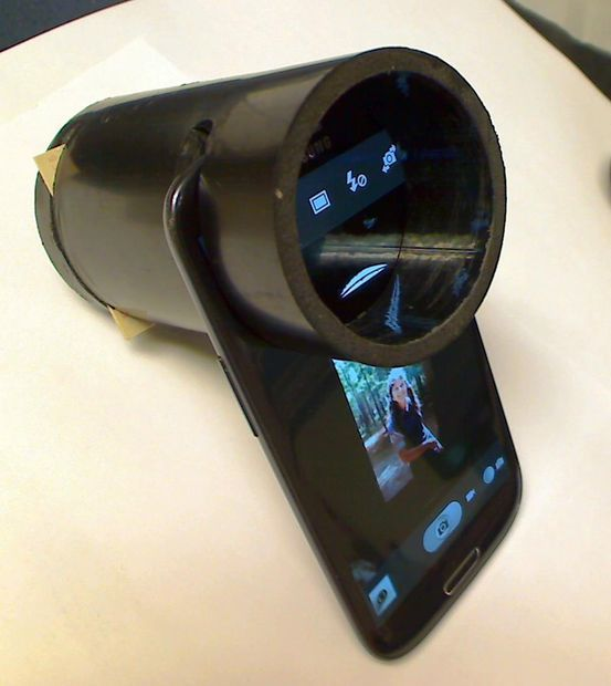 How to capture your old slides into digital on your phone with PVC pipe and paper! Very cool. This is a must to share!