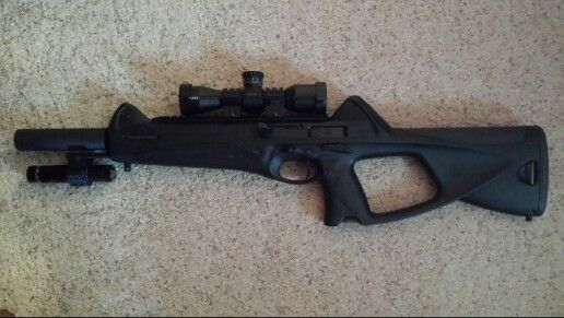 Beretta CX4 Storm .40 S&W with barrel shroud, Maglite, and Nikon compact scope.  Accepts PX4 mags.