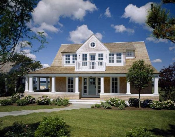 The front porch of a beautiful new shingle style home on for Cape cod homes with front porches