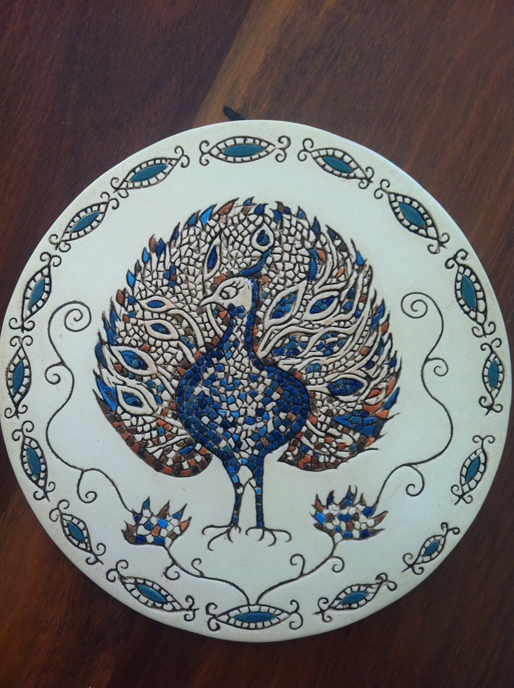 Carved ceramic plate (2011), my version of 'The Peacock' mosaic found in The House of Dionysos', Paphos, Cyprus, mid Roman period.