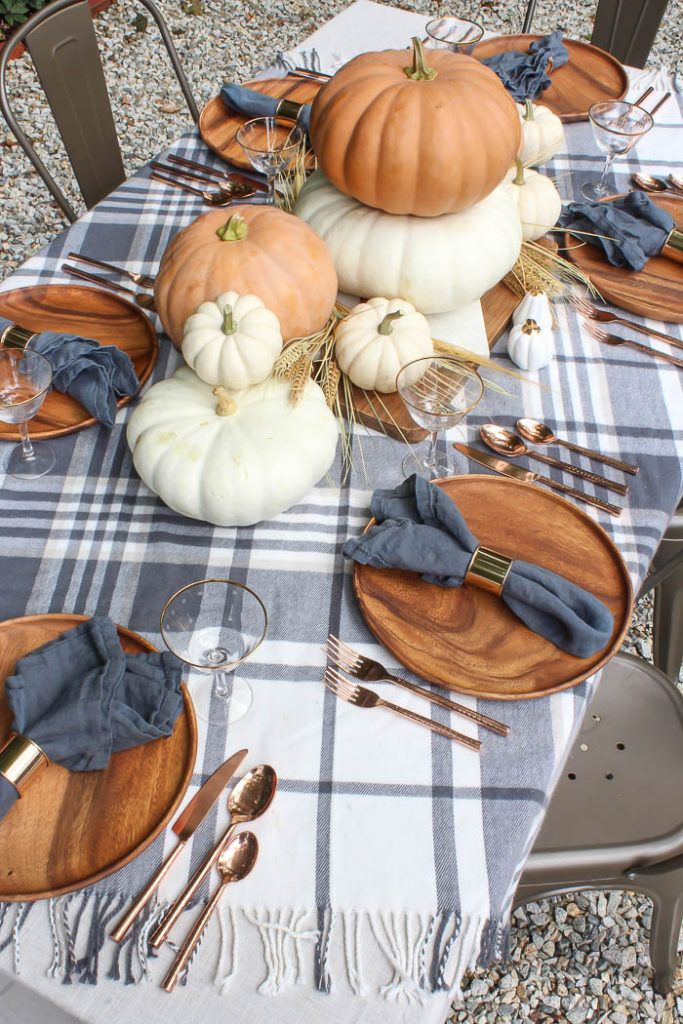 Orange & Gray Fall Tablescape | loving this fall tables cape with orange & white pumpkins, grey buffalo check decor, and wooden dishes! #homedecor #fa…