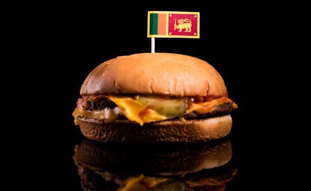 sri lankan flag on top of hamburger isolated on black background