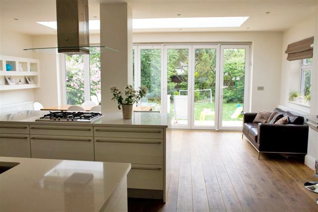 Completely change the layout of kitchen diner? Modern open plan kitchen looking out on to the garden.