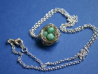 Silver and green birds nest pendant created with vintage beads- upcycled jewellery.