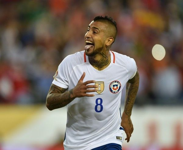 Chile's Arturo Vidal celebrates after scoring a penalty against Bolivia during the Copa America Centenario football tournament in Foxborough, Massachusetts, United States, on June 10, 2016.  / AFP / Hector RETAMAL