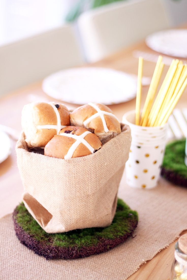 Our jute sacks come in 3 sizes and can be filled up with hot cross buns.  Let your guests help themselves (small pictured here).  http://www.hipandhooray.com.au/jute-sack-small