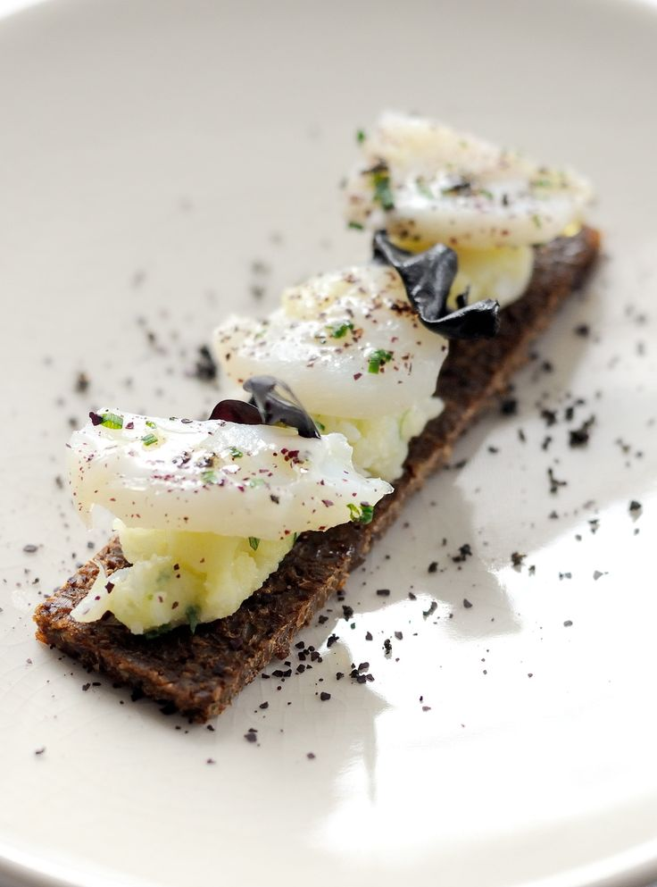 Cod brandade is an emulsion of cod and olive oil, traditionally eaten in the winter with bread or potatoes.In this cod branadade recipe Agnar Sverrisson lifts the dish to a light plane with the addition of pumpernickel and salty olives. #plating #presentation