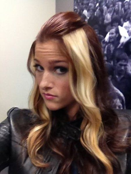 Love her hair!!! Maybe...blonde under dark, no one would see my eventual roots! lol