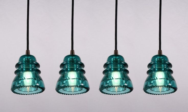 Farmhouse light fixtures from old glass insulators.