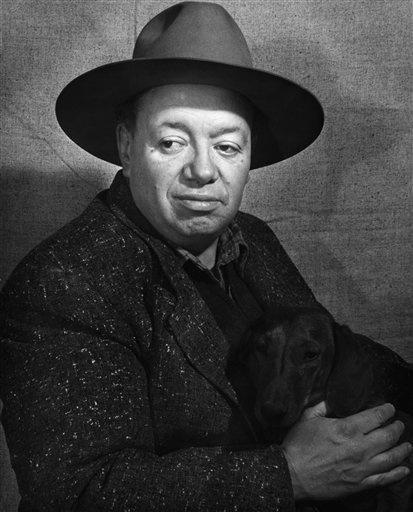 Mexican artist Diego Rivera with his dachshund.