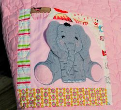 Favorite baby clothes turned into a keepsake quilt - what a sweet 1st birthday gift.
