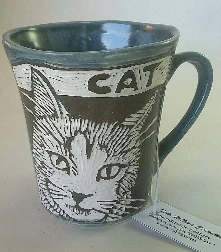 Sgraffito carved cat mug.  Holds 250ml liquid.