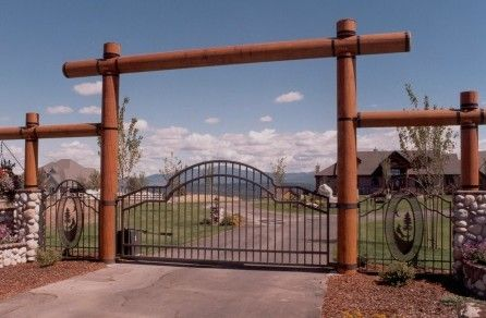 Entry With Gate, Fence, Logs And Stone Columns.. would love to have this in front of my ranch style home one day!