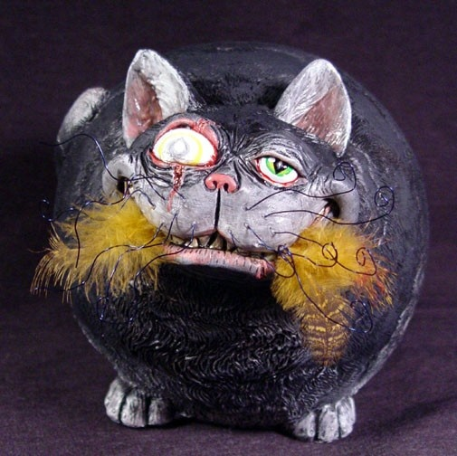 """Goliath eating a canary zombie psycho  kitten pussy by UndeadEd Size: 8"""" inches round  I recently found this cat who was real cute and simple at a local pottery store. I knew instantly what I wanted to do! I decided to make a psycho cat and my girl friend named him after her cat Goliath. Well this big guy just ate a canary so he is very happy!  Comes with a certificate of authenticity"""