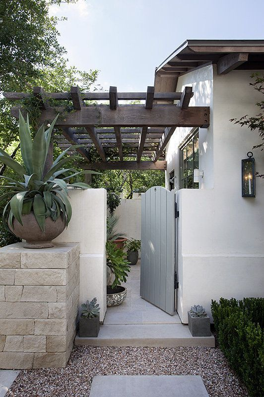 Mediterranean-style home rear entrance - Ryan Street & Associates #OutdoorLiving #ShadesOfGray