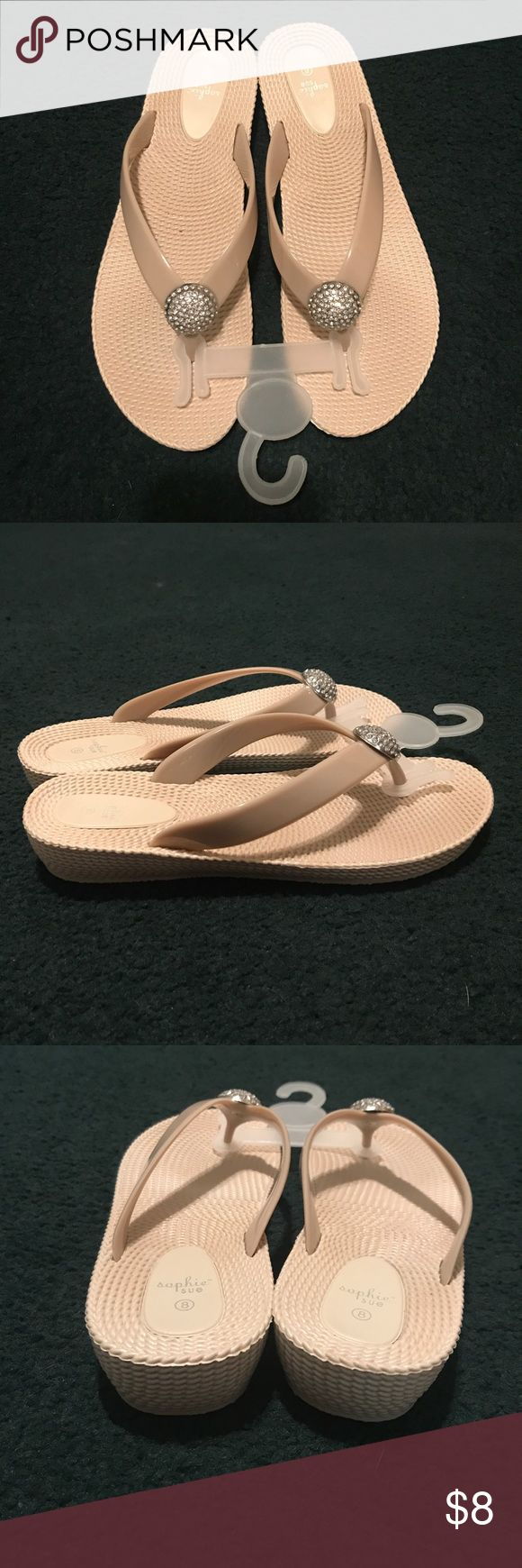 New wedge flip flops size 8 New wedge flip flops size 8. Wedge is 1 1/4 inch high. Jewel detail on front. Shoes Sandals