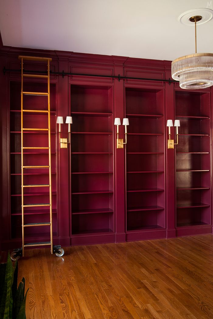 Bold & beautiful. We have serious room envy for The Makerista's rich berry hued library shelves.