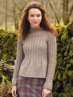 Knit this lovely, bell shaped sweater with cable-detail.  Designer: Marie Wallin