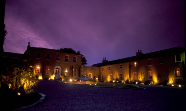 Outside view of Ballinacurra House by night