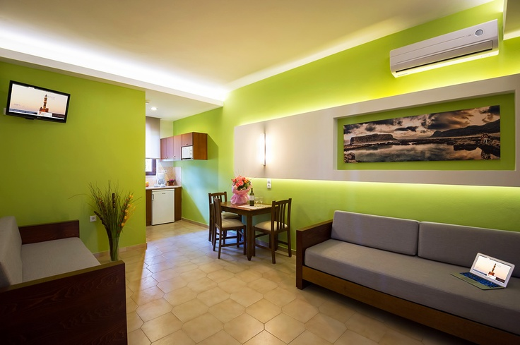 Beautiful and modern interior design at Oscar Suites & Village. Complete with sofas, fully equipped kitchen, dining area, TV and air-condition. More info at http://www.oscarvillage.com/accommodation-one-bedroom-suites