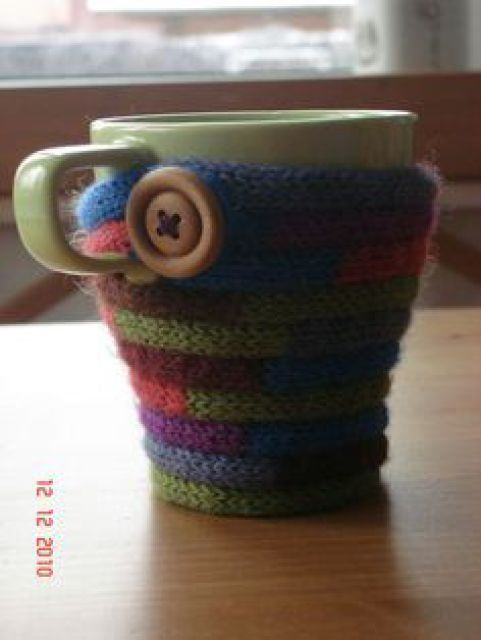 Easy knitted cord mug cosy.