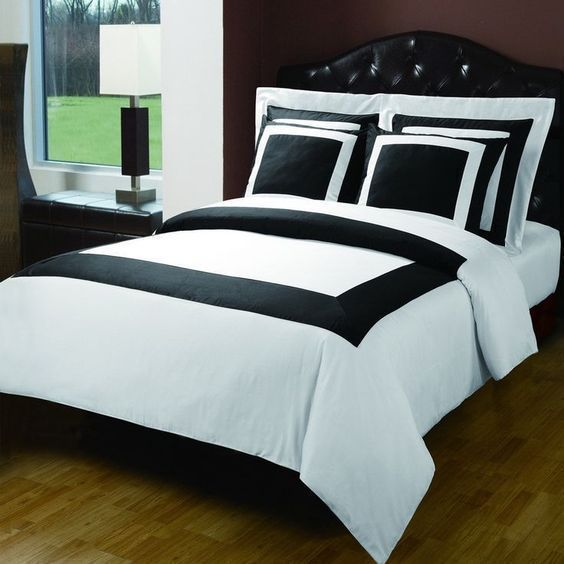 Modern Hotel Style Black and White 100 percent Egyptian Cotton Frame Duvet Comforter Cover and Shams Set. Bedding set includes duvet cover and 4 pillow shams. It features a large band accent for a chic 5 stars hotel look.
