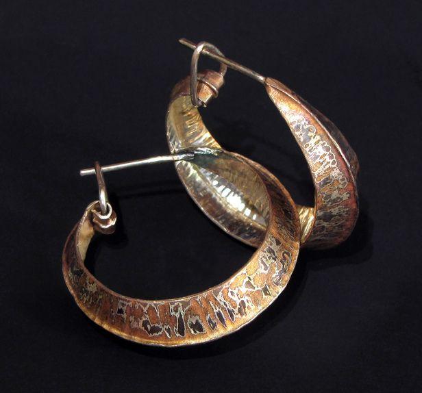 Luna earrings by Victoria Lansford. Fold-formed hoop earrings of straight grain mokume fane. Sterling, shibuichi, copper