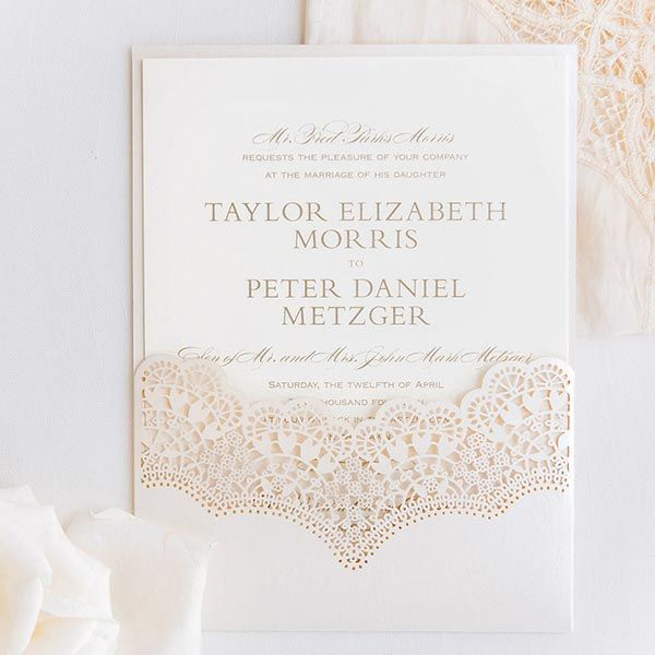 A beautifully intricate laser-cut pocket offered a sneak peek of the couple's sophisticated Southern wedding affair.